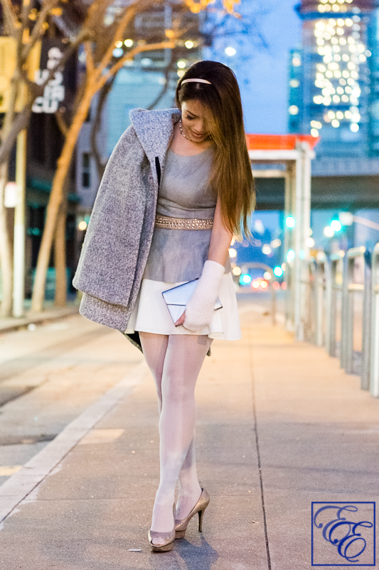 Light grey cape, peplum top, white flared skirt, grey hosiery, arm warmers, and metallic pumps and clutch: entire outfit