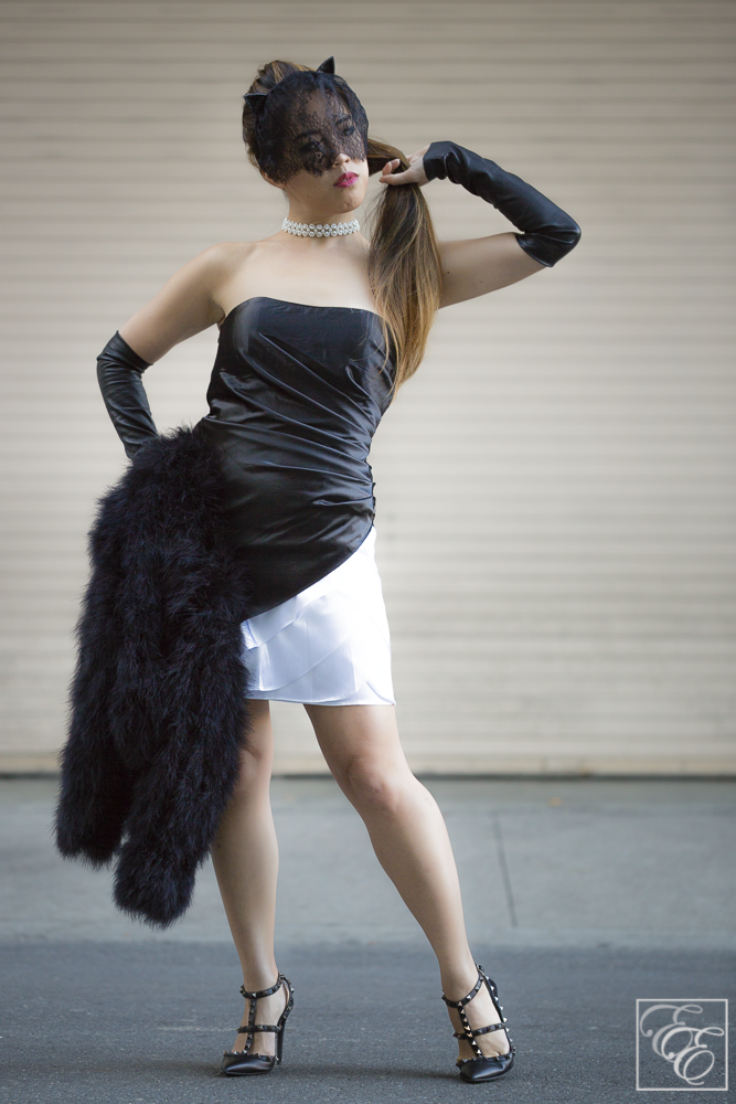 Ostrich feather coat, black leather sleeves, LBD, lace cat-ear headband, and Valentino rockstuds. Styling tips at EyeForElegance.com