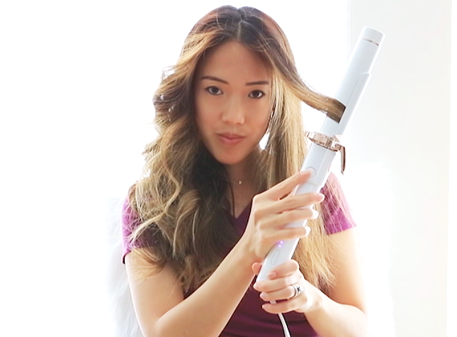 How to curl hair with T3 Twirl360 curling iron - pressing button to activate rotating mechanism