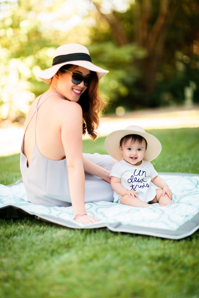 mama wearing Tobi shift dress, Bebe sunhat, Chanel glasses, baby girl wearing Joe Fresh top